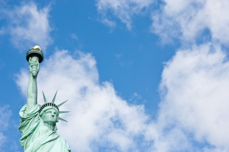 Sunnny day, blue sky with clouds: statue of Liberty with copy space photo
