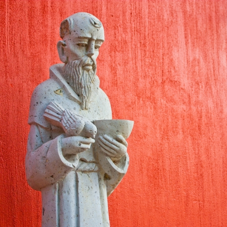 Saint Francis statue at the entrance of a Mexican church