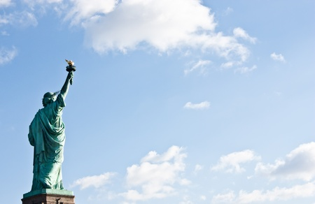 liberty torch: Sunnny day, blue sky with clouds: statue of Liberty with copy space Stock Photo
