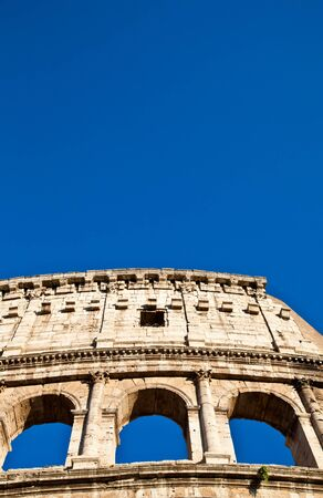 Colosseum in Rome with blue sky, landmark of the city photo