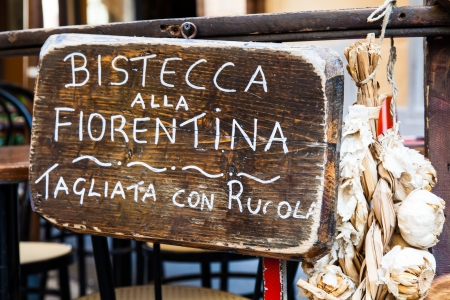 Sign made of wood with Bistecca alla Fiorentina (Florence steak) words