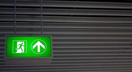 Emergency exit sign in modern offices inside an industrial plant Stock Photo - 15302575