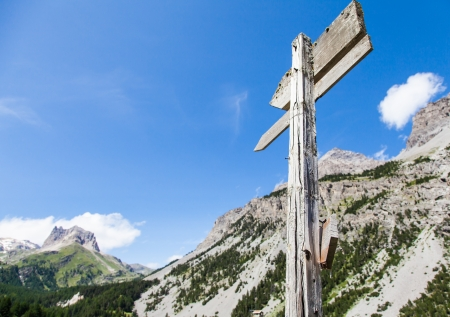 Italian Alps, close to Bardonecchia town. Mountain direction sign during a sunny day in summer season. photo