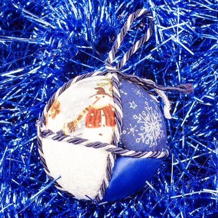 Italy. Traditional handmade Christmas ball made of white and blue fabric photo