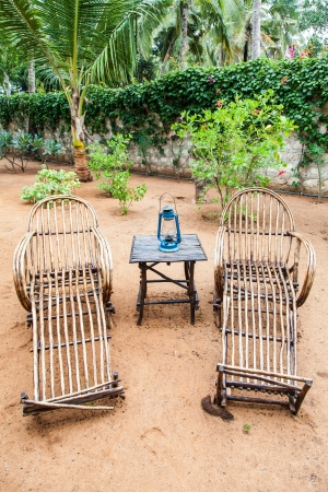Kenya. Elegant furniture made of wood in an African garden photo