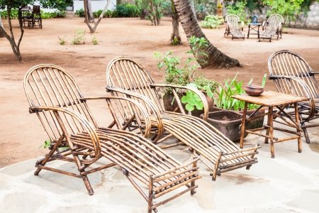 Elegant furniture made of wood in an African garden, Kenya. photo