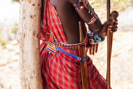 Kenya. Detail of the traditional Masai red costume. photo