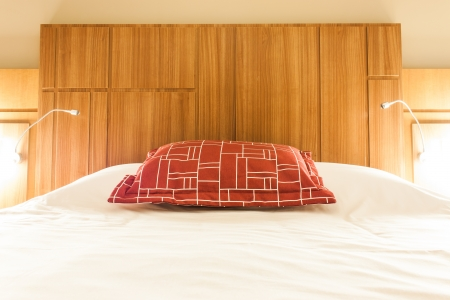 A design red pillow in a modern style bedroom Stock Photo - 17012917