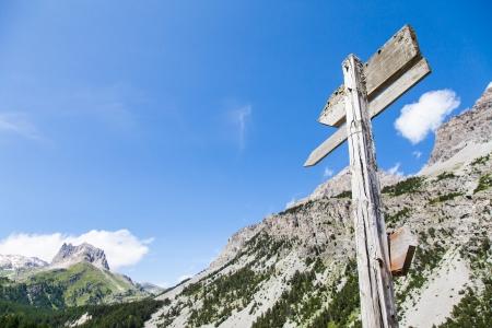 Italian Alps, close to Bardonecchia town. Mountain direction sign during a sunny day in summer season. photo