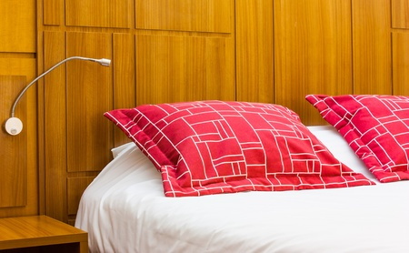 A design red pillow in a modern style bedroom photo