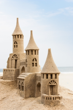 fantasy castle: Grand sandcastle on the beach during a summer day