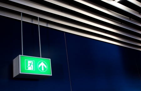 Emergency exit sign in modern offices inside an industrial plant Stock Photo - 17462531