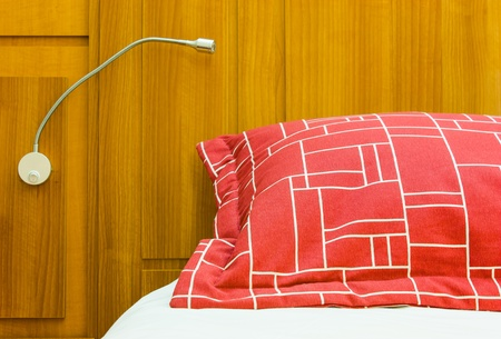 A design red pillow in a modern style bedroom Stock Photo - 17750002