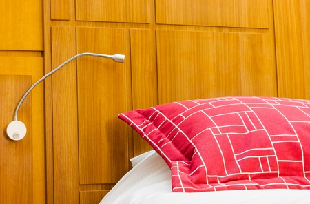 A design red pillow in a modern style bedroom Stock Photo - 18135680