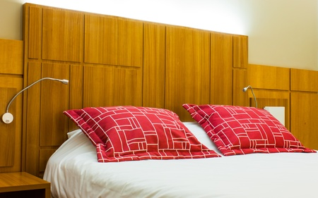 A design red pillow in a modern style bedroom Stock Photo - 18383402
