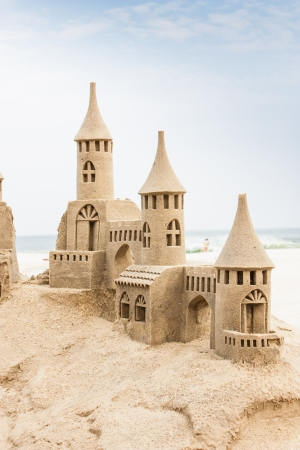 Grand sandcastle on the beach during a summer day photo