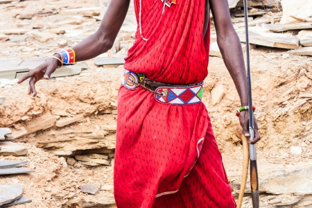 Kenya. Detail of the traditional Masai red costume.