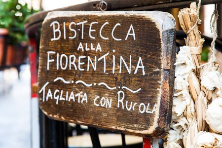 Sign made of wood with Bistecca alla Fiorentina (Florence steak) words Stock Photo - 18852727