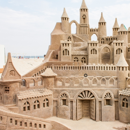 sand castle: Grand sandcastle on the beach during a summer day