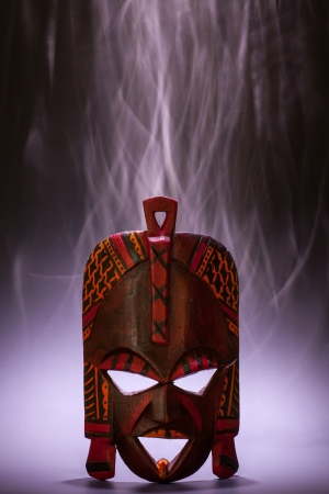 tradional: Tradional mask from Kenya (made of wood) with smoke effect useful for concepts Stock Photo
