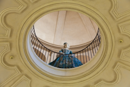 Mannequin dressed in old fashion (18th century). Interior of an old Italian palace. photo