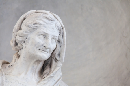 Ancient statue of an aged woman in an Italian church close to Torino, north Italy photo
