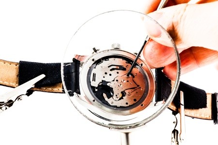 Elegant watch repaired using a magnifier with three handles photo
