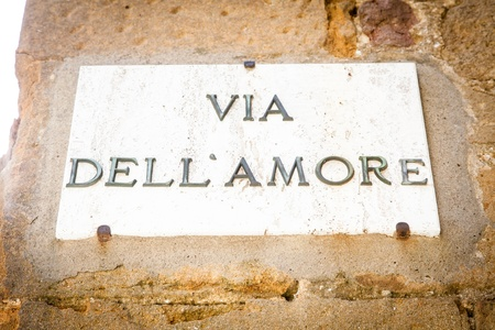 Italy - Pienza town. The streetsign of Via dellamore (Love Street) photo