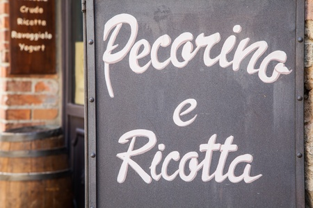 Tuscany, Italy. List of cheeses in front of a traditional cheese shop, said Cacioteca photo