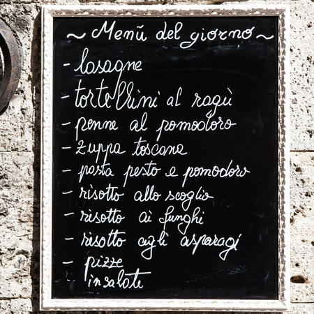 Tuscany, Italy. A turistic menu exposed on a blackboard outside a restaurant photo