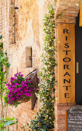 orcia: Tuscany, Italy. Sightseeing of Italian Restaurant in traditional small village in Val Orcia