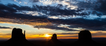 navajo land: Wonderful colours during sunrise in this iconic view of Monument Valley, USA