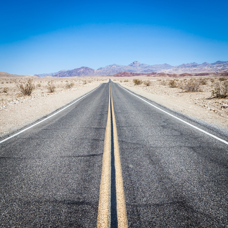 Road prospective in the middle of Death Valley desert, USA photo