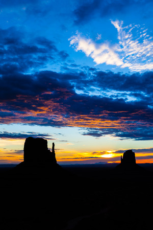 Wonderful colours during sunrise in this iconic view of Monument Valley, USA photo