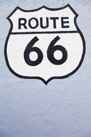 Famous streetsight of Route 66 painted on a wall in Flagstaff photo