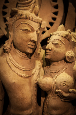Indian lovers sculpture in tantric position photo
