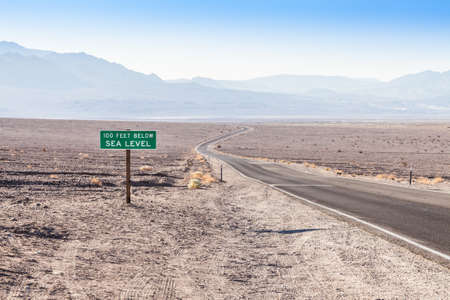valley below: Death Valley, USA. Road sight in the middle of the desert