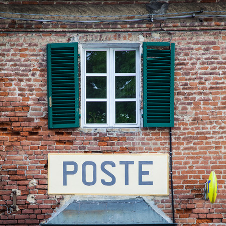 Tuscany, Italian postal office sign on old wall. photo