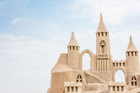 Grand sandcastle on the beach during a summer day