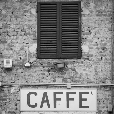 Tuscany, Italy. Old Caffè sign under a traditional Italian window photo