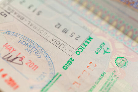 Detail of passport page with international entry visa photo