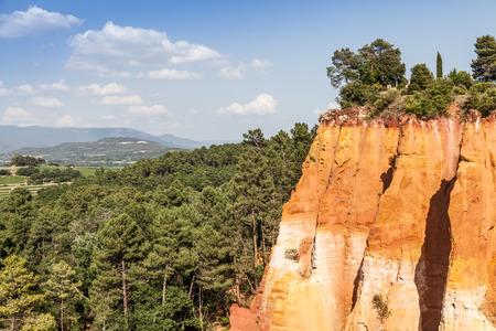 noted: France - Roussillon, noted for its large ochre deposits found in the clay surrounding the village. Stock Photo