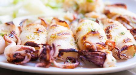 Fresh calamari served in an old Italian restaurant (Tuscany). Daylight. photo