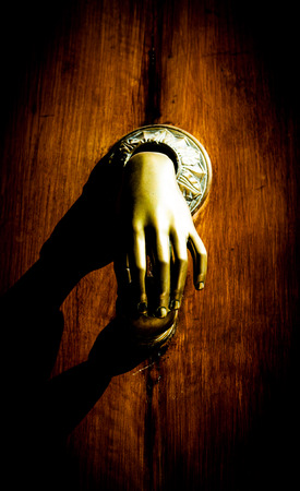 doorknocker: Full of mistery in this detail of ancient knocker. Stock Photo
