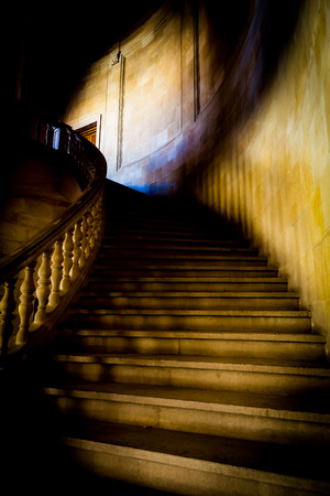 Old staircase made of pure white marble in gothic mood photo