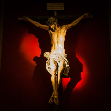 Ancient Spanish Crucifix made of wood, 300 years old. Archivio Fotografico