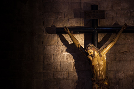 Old medieval crucifix in Italian church - made of wood