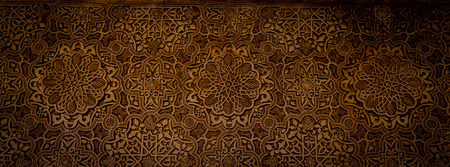 learning arabic: Wall detail of Alhambra UNESCO site in Granada - South of Spain. 600 years old arabic characters.