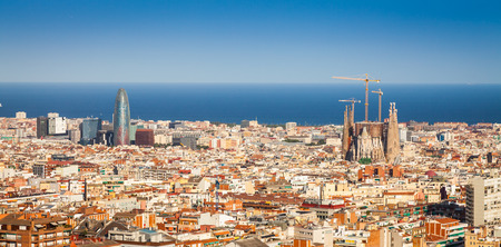 barcelona spain: Barcelona - Spain. Wonderful blue sky during a sunny day on the city, with Sagrada Familia view. Editorial