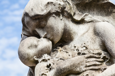 angel headstone: Cemetery statue in Italy, made of stone - more than 100 years old Stock Photo